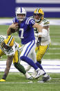 Indianapolis Colts quarterback Philip Rivers (17) scrambles with the ball in an NFL game against the Green Bay Packers, Sunday, Nov. 22, 2020 in Indianapolis. The Colts defeated the Packers 34-31. (Margaret Bowles via AP)
