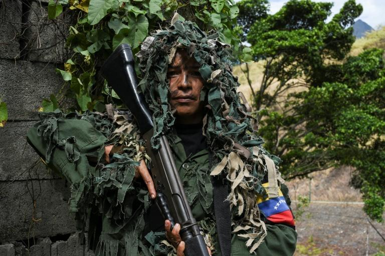 Ismaira Figueroa, a sniper for the Bolivarian militia, carries a Belgian-made 7.62 mm caliber FAL rifle while taking part in military exercises in Caracas