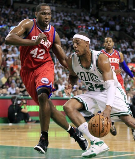 Boston Celtics forward Paul Pierce (34) drives against Philadelphia 76ers forward Elton Brand (42) during the first quarter of Game 7 in the NBA basketball Eastern Conference semifinal playoff series, Saturday, May 26, 2012, in Boston. (AP Photo/Elise Amendola)