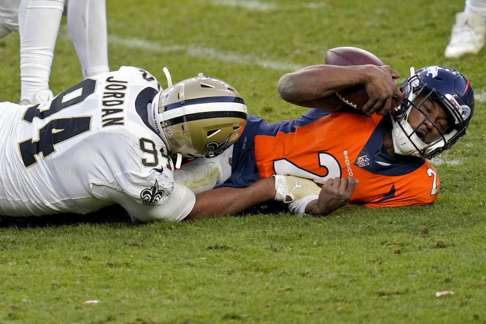 New Orleans Saints defensive end Cameron Jordan (94) sacks Denver Broncos quarterback Kendall Hinton (2) during the second half of an NFL football game, Sunday, Nov. 29, 2020, in Denver. (AP Photo/David Zalubowski)