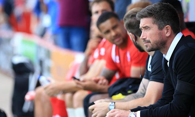 Crawley Town's manager Harry Kewell keeps an eye on proceedings at Broadfield Stadium, where Cambridge were the visitors and the victors on Saturday.
