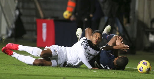Panama's Jorman Aguilar, left, and United States' Reggie Cannon fall as they compete for the ball during the international friendly soccer match between the USA and Panama at the SC Wiener Neustadt stadium in Wiener Neustadt, Austria, Monday, Nov. 16, 2020. (AP Photo/Ronald Zak)