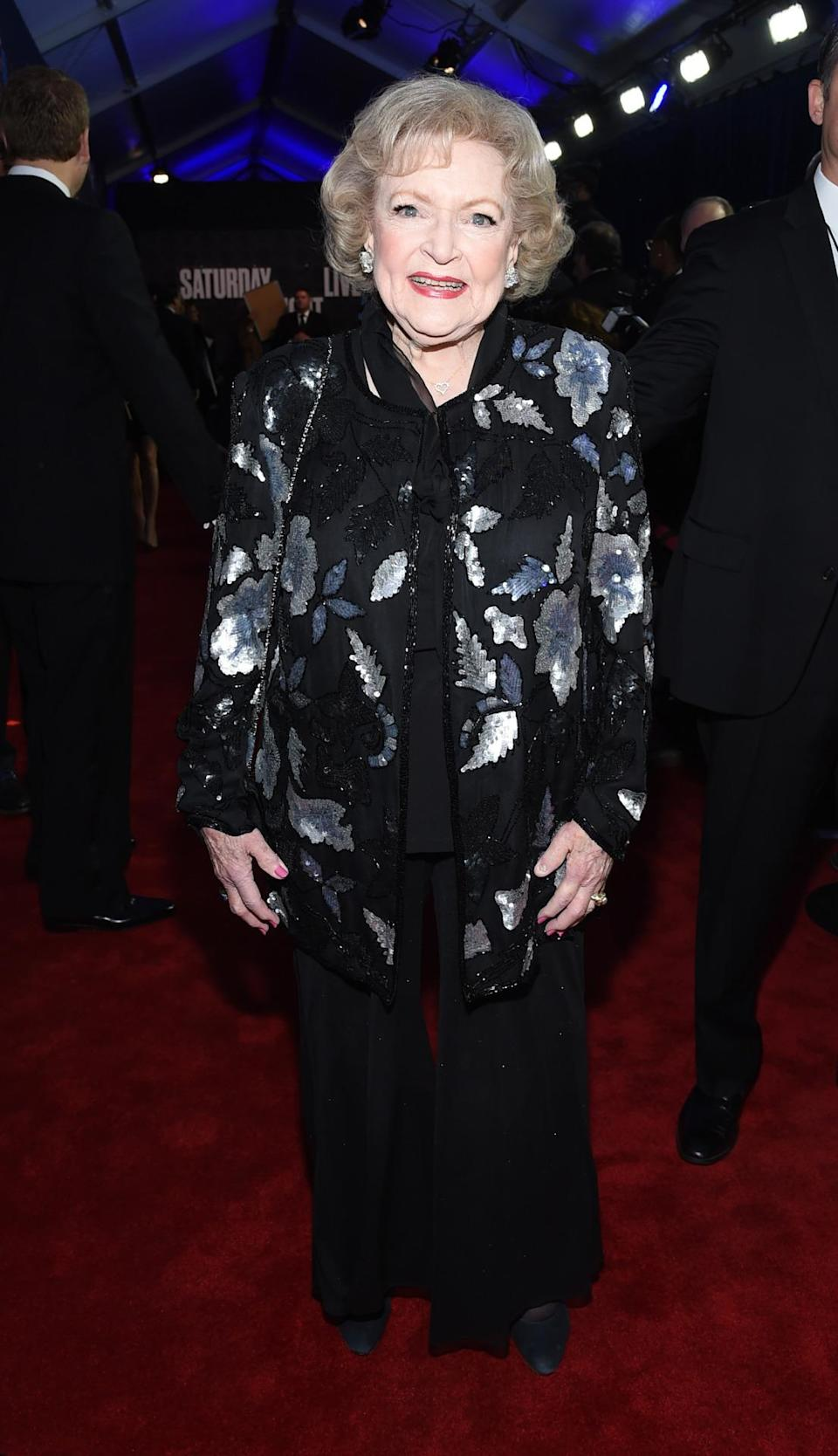 Before hitting the famed SNL stage and making out with Bradley Cooper, the 93-year-old actress was on trend in dark florals and flare pants.