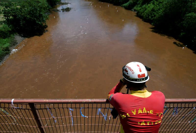 FILE PHOTO: Rescue worker reacts during a demonstration in honor of victims of the collapse of a dam owned by Brazilian mining company Vale SA, in Brumadinho