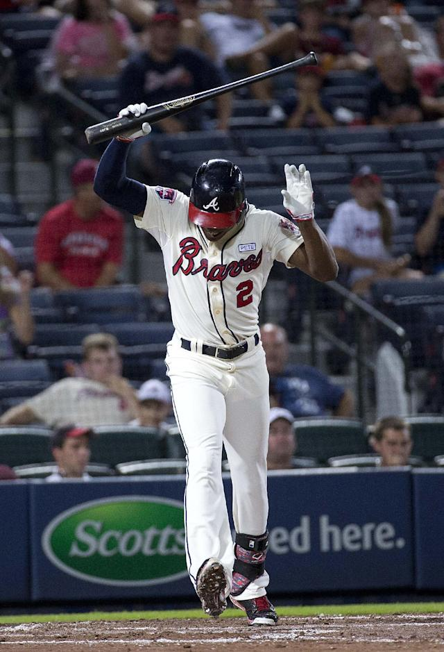 Atlanta Braves' B.J. Upton reacts after striking out in the third inning of a baseball game against the Washington Nationals on Saturday, Aug. 9, 2014, in Atlanta. (AP Photo/John Bazemore)