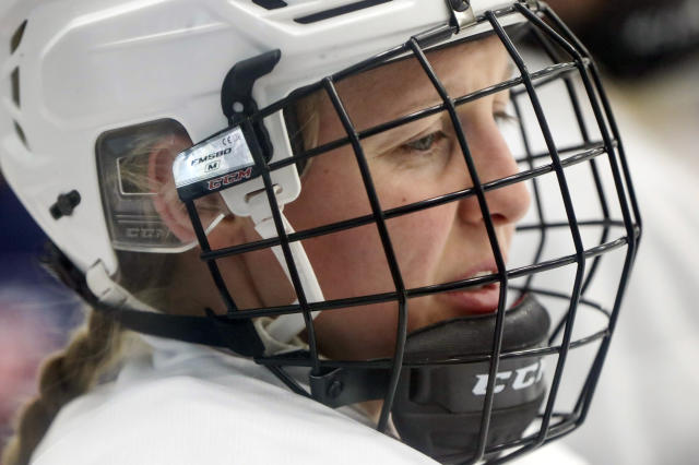 """In this photo taken Monday, Nov. 4, 2019, Kendall Coyne-Schofield, a member of the U.S. Women's National hockey team, goes through drills during their practice in Cranberry Township, Butler County, Pa. While the WNBA continues to grow and women's professional soccer is capitalizing off a World Cup bump, women's hockey remains at a standstill with top players opting not to play professionally in North America in hopes of eventually creating a sustainable league with salaries that allow them to focus on their game and not just getting by. """"For me, my clock is ticking,"""" Schofield said. """"But if I can leave this game better than it was, that's what's most important."""" (AP Photo/Keith Srakocic)"""