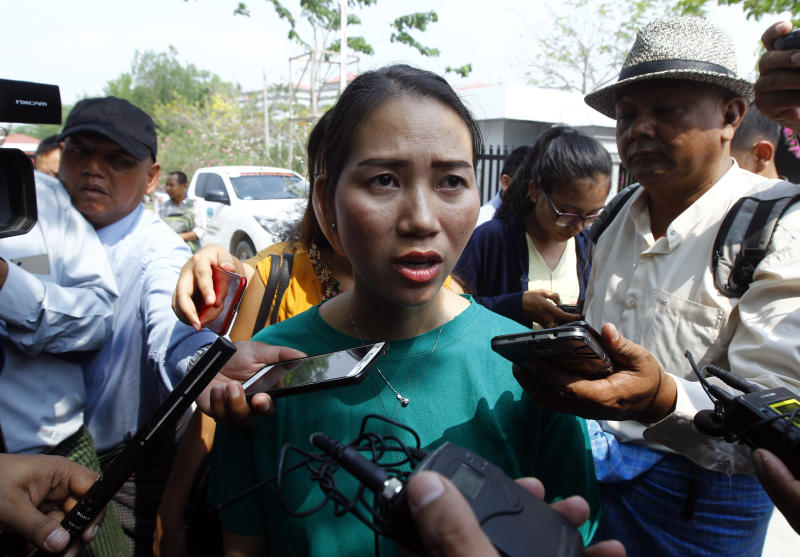 Pan Ei Mon, wife of Reuters journalist Wa Lone, talks to journalists as she leaves the Supreme Court in Naypyitaw, Myanmar, Tuesday, April 23, 2019. Myanmar's Supreme Court on Tuesday rejected the final appeal of two Reuters journalists and upheld seven-year prison sentences for their reporting on the military's brutal crackdown on Rohingya Muslims. (AP Photo/Aung Shine Oo)