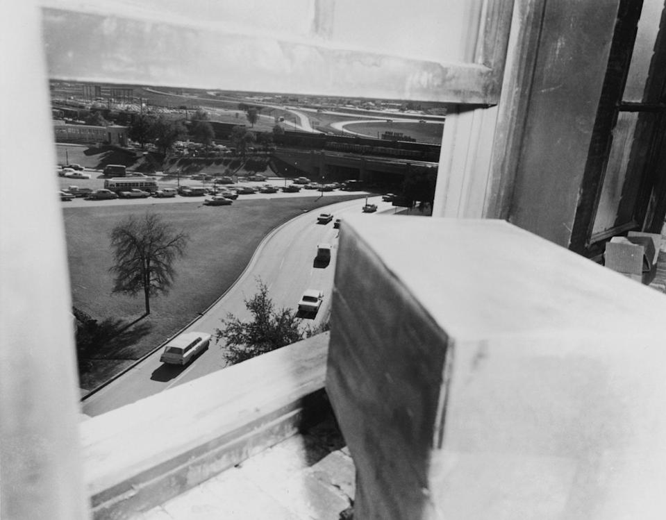 The view from the sixth floor window of the Texas School Book Depository in Dallas, from which Lee Harvey Oswald is thought to have assassinated President John F. Kennedy, Nov. 22, 1963. This photograph was taken approximately one hour after the assassination. (Photo: Hulton Archive/Getty Images)