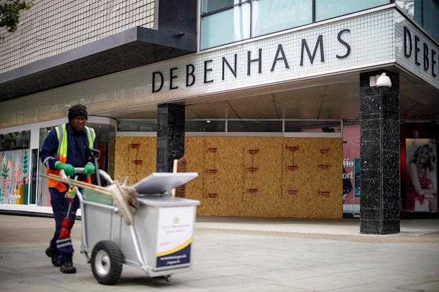 A Debenhams department store, boarded up and closed-down due to coronavirus, on Oxford Street in London. (Tolga Akmen/AFP via Getty Images)