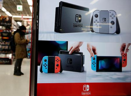 Monitor showing Nintendo Switch game consoles is seen at an electronics store in Tokyo