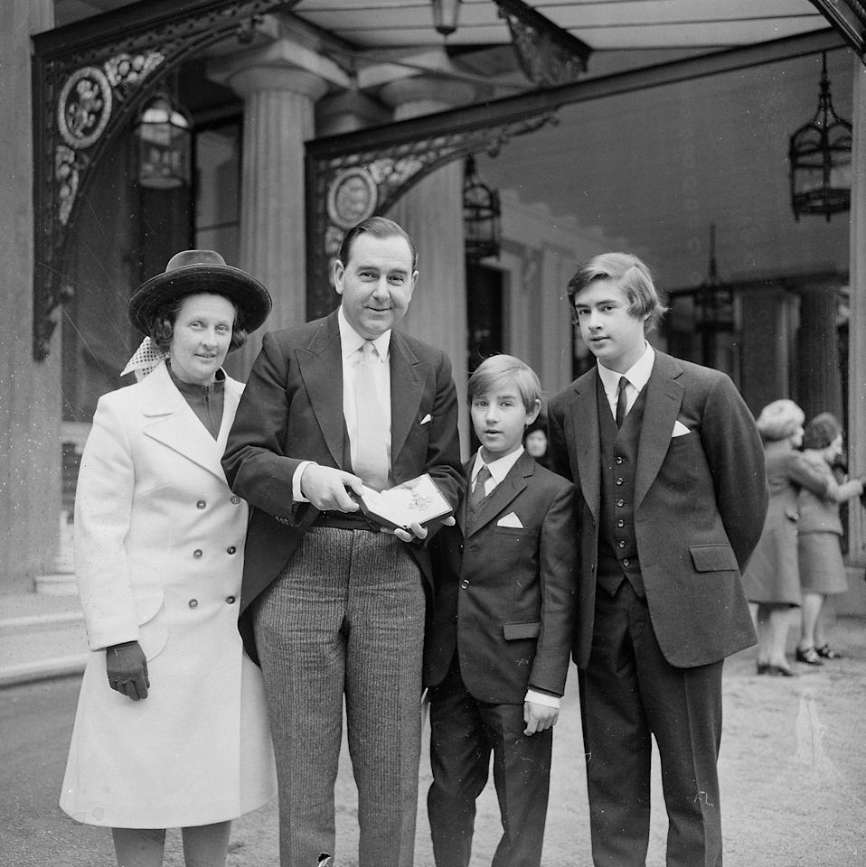 15th February 1972:  England and Kent cricketer Colin Cowdrey  (1932 - 2000) with his wife Peggy and two sons Jeremy and Christopher after receiving his OBE from the Queen at Buckingham Palace, London.  (Photo by Michael Webb/Keystone/Getty Images)