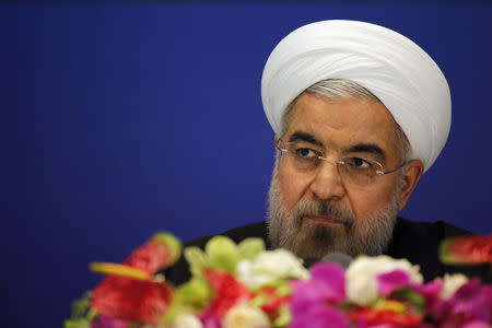 Iran's President Hassan Rouhani arrives to attend a news conference at a hotel after the fourth CICA summit, in Shanghai