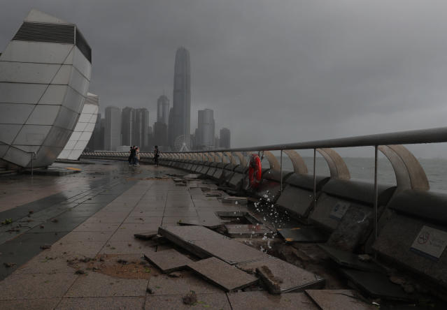 <p>Debris caused by Typhoon Hato damage is strewn across the waterfront of Victoria Habour in Hong Kong, Wednesday, Aug. 23, 2017. (Photo: Vincent Yu/AP) </p>