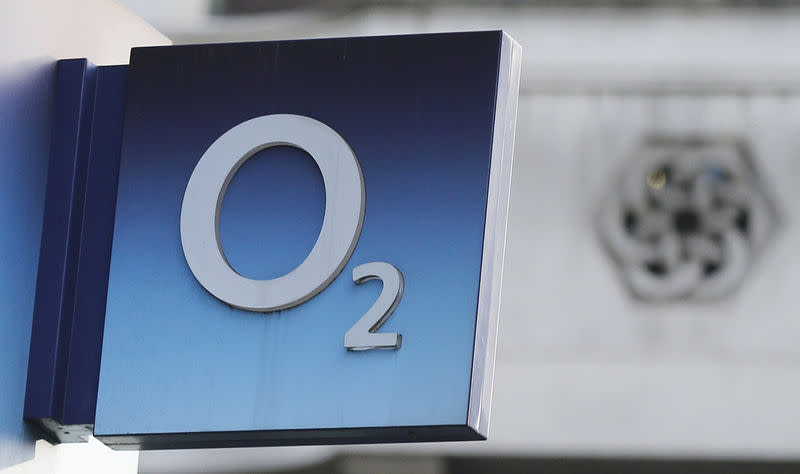 A sign hangs outside an O2 mobile phone shop in central London