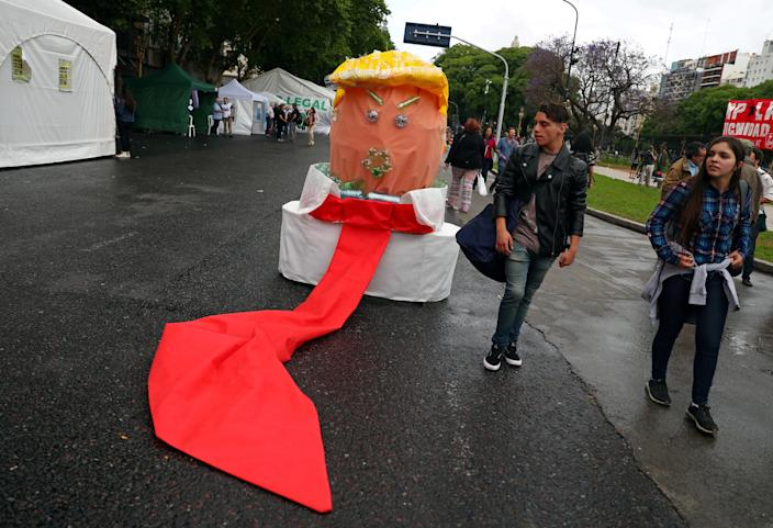A figure made of recycled materials resembling President Trump is seen during a protest ahead of the G-20 leaders summit in Buenos Aires, Argentina, on Thursday. (Photo: Pilar Olivares/Reuters)