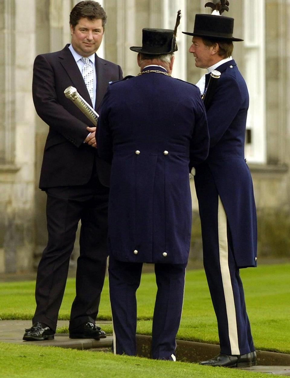 Michael Fawcett during a garden party at the Palace of Holyroodhouse in Edinburgh in 2004 (PA) (PA Archive)