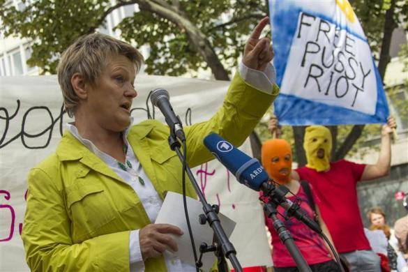 Germany's Green Party parliamentary faction co-leader Renate Kuenast (L) speaks during a support rally for the detained Moscow based feminist punk band Pussy Riot outside the Russian embassy in Berlin, August 17, 2012.