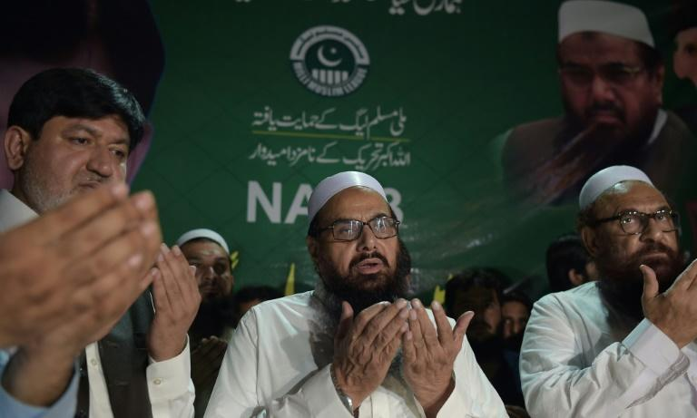 Hafiz Saaed (C) even courted the limelight, giving public speeches and television interviews