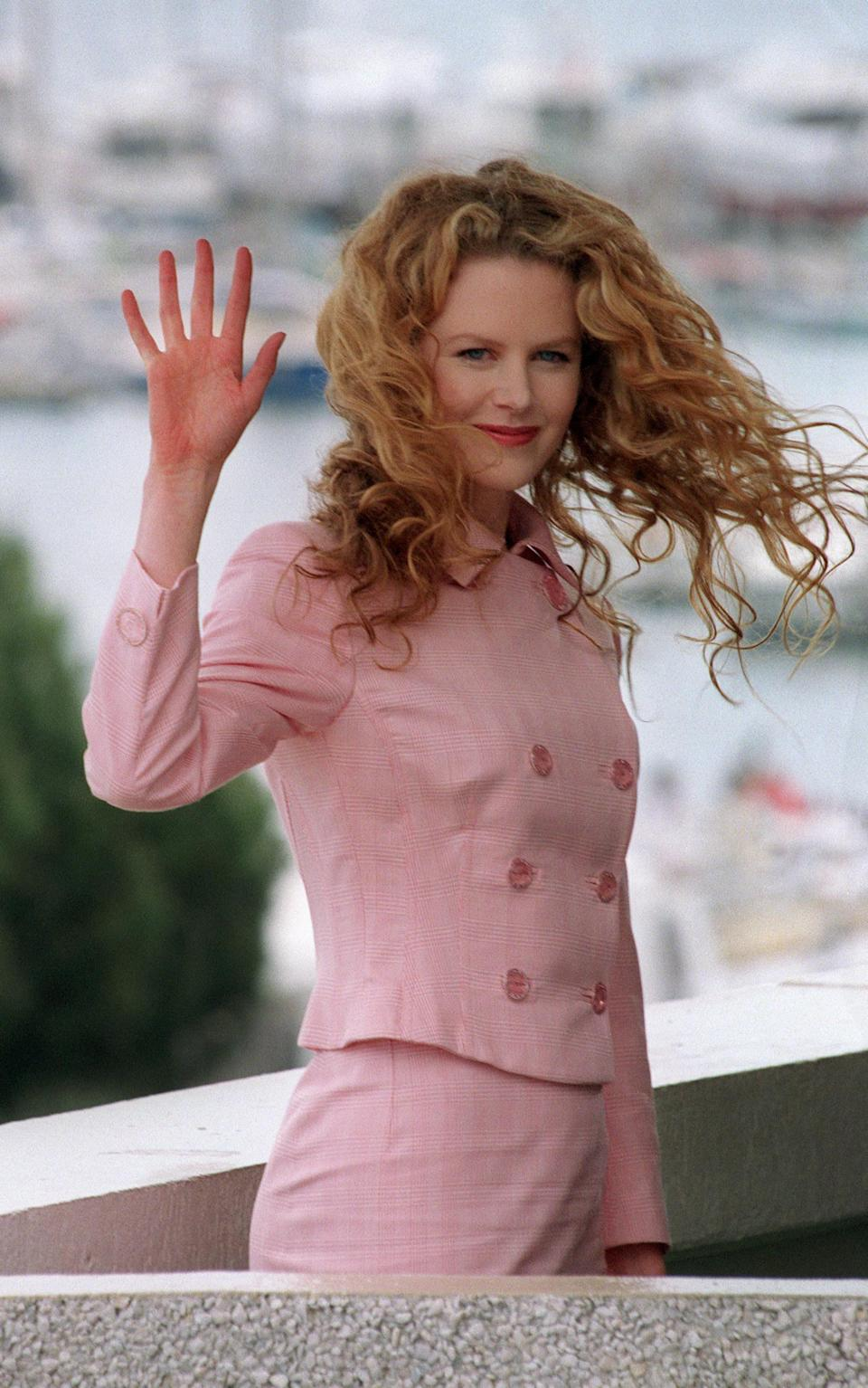 Nicole waving at an event