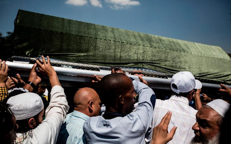 Pallbearers carry the coffin of Anti-apartheid stalwart Ahmed Kathrada during the funeral of Kathrada - Credit: AFP