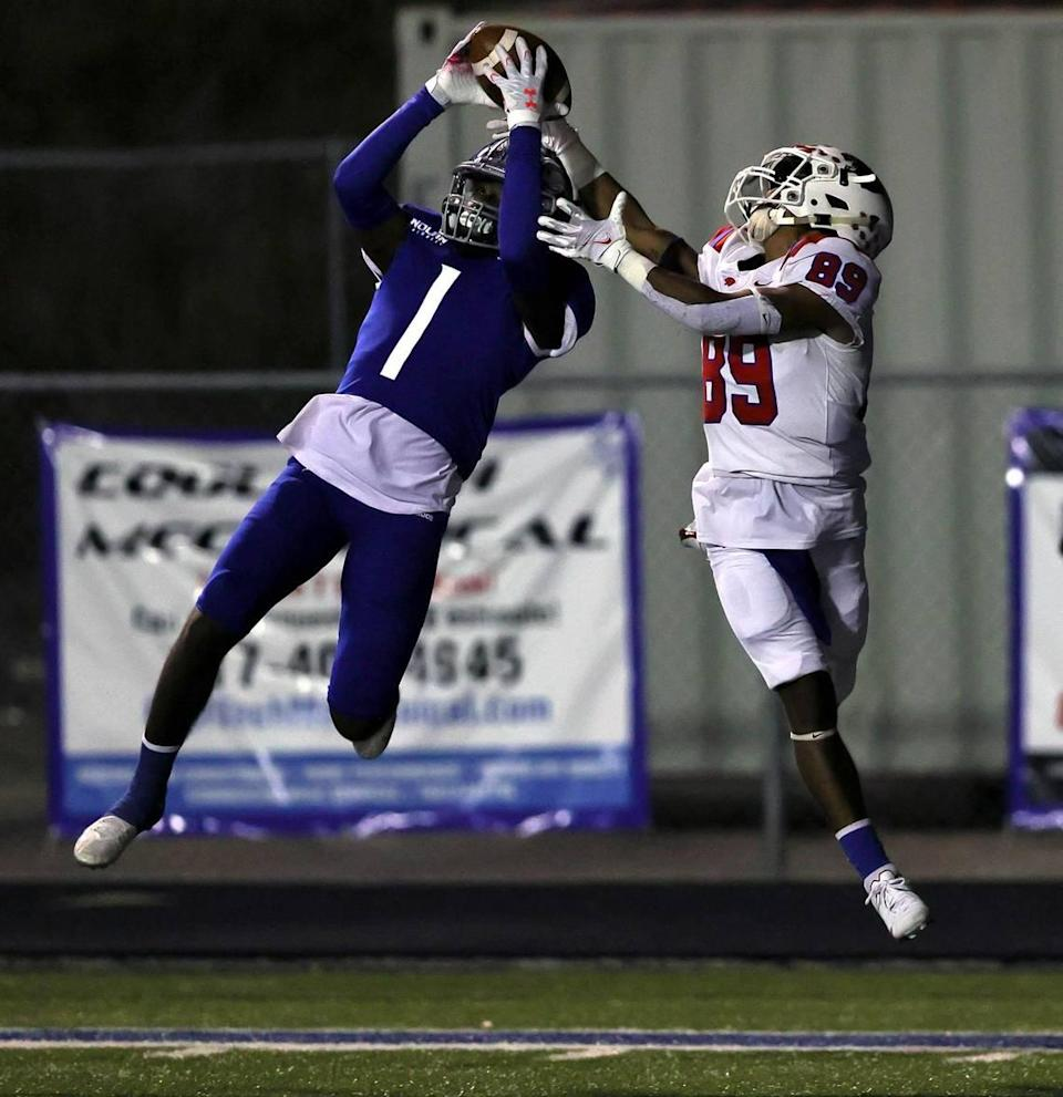 Nolan defensive back Keontae Williams (1) comes up with an interception in front of Parish Esiscopal receiver Jai Moore (89) during the first half of a high school football game, November 13, 2020 played at Doskocil Stadium in Fort Worth, Tx. (Steve Nurenberg Special to the Star-Telegram)