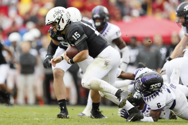 Iowa State quarterback Brock Purdy (15) is tackled by TCU safety Innis Gaines (6) during the first half of an NCAA college football game, Saturday, Oct. 5, 2019, in Ames, Iowa. (AP Photo/Charlie Neibergall)