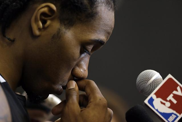 San Antonio Spurs forward Kawhi Leonard listens to a question during practice on Saturday, June 7, 2014, in San Antonio. The team plays Game 2 of the NBA Finals against the Miami Heat on Sunday. (AP Photo/Eric Gay)