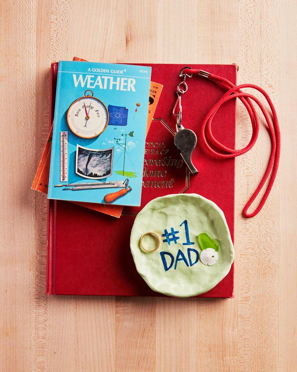 """<p>Make dad a catch-all dish where he can stash those trinkets you collect together on your outdoor adventures.</p><p><strong>To make:</strong> Pinch and shape oven-bake clay into a small, shallow dish. Bake according to manufacturers directions. Paint as desired with acrylic paint. Once dry, seal with satin-finish Mod Podge.</p><p><a class=""""link rapid-noclick-resp"""" href=""""https://www.amazon.com/Fimo-Soft-Modelling-Clay-White/dp/B000N6K69Q/ref=sr_1_4?tag=syn-yahoo-20&ascsubtag=%5Bartid%7C10050.g.1171%5Bsrc%7Cyahoo-us"""" rel=""""nofollow noopener"""" target=""""_blank"""" data-ylk=""""slk:SHOP OVEN-BAKE CLAY"""">SHOP OVEN-BAKE CLAY</a></p>"""