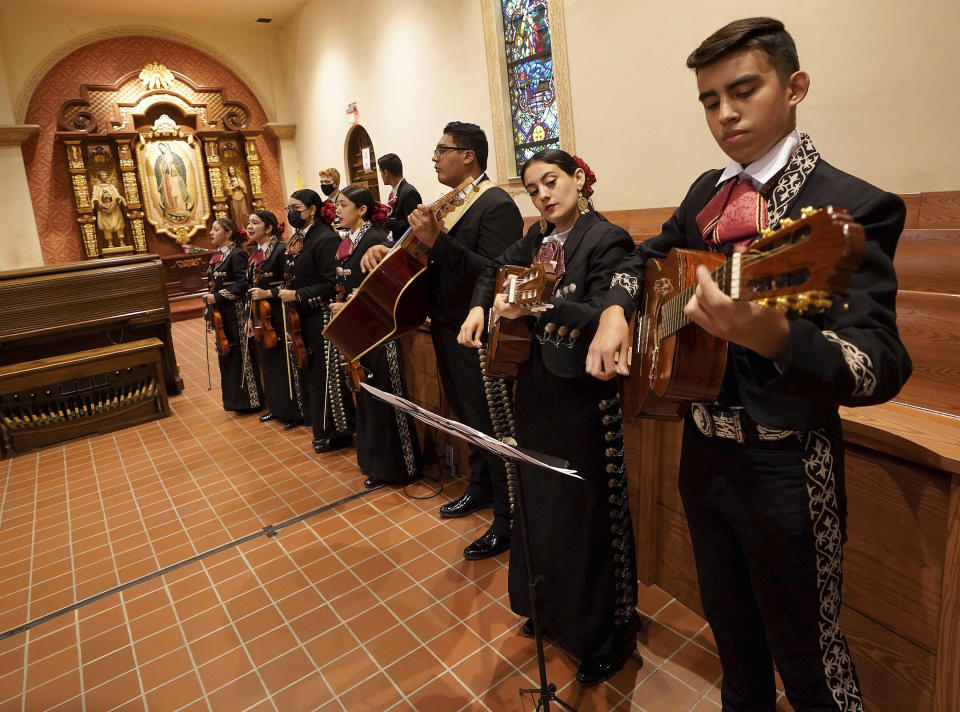 Mariachi band Los Changuitos Feos (Ugly Little Monkeys) preform for parishioners during a morning Mass at St. Augustine Cathedral Sunday, Aug. 18, 2021 in downtown Tucson. While mariachi is a popular genre at its core, musicians and parishioners alike say its emotional interplay between trumpet, violin, guitar, vihuela and guitarrón are a natural complement to the holy rites of Mass. (AP Photo/Darryl Webb)