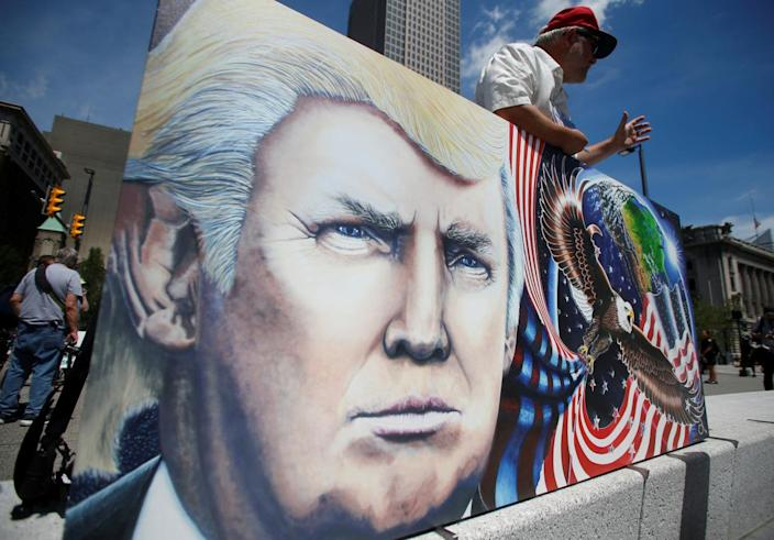 <p>Julian Raven, a supporter of Republican presidential candidate Donald Trump, holds his artwork at the Public Square in Cleveland, Ohio, on July 17, 2016. (Photo: Jim Urquhart/Reuters)</p>