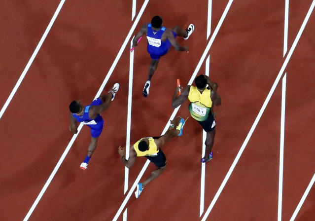 Athletics - World Athletics Championships - Men's 4x100 Metre Final - London Stadium, London, Britain – August 12, 2017. Yohan Blake of Jamaica passes the baton to Usain Bolt before he sustains an injury. REUTERS/Fabrizio Bensch