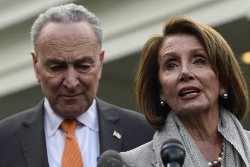 """House Speaker Nancy Pelosi and Senate Minority Leader Chuck Schumer have been unable to forge a deal with the president and accused Trump of throwing a """"temper tantrum"""" during a meeting this week. (Susan Walsh/Associated Press)"""