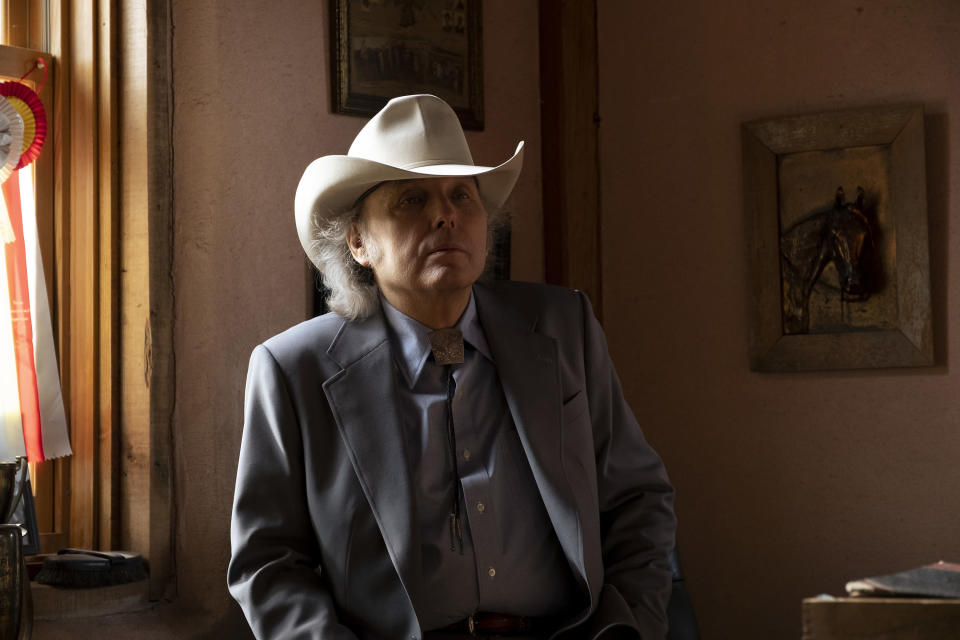 """This image released by Warner Bros. Pictures shows Dwight Yoakam in a scene from """"Cry Macho."""" (Claire Folger/Warner Bros. Pictures via AP)"""