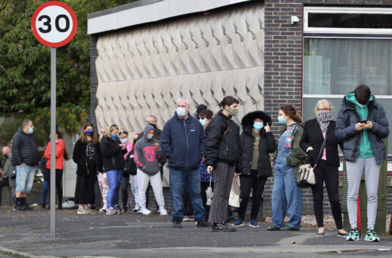People at a test centre in Liverpool, which has the country's third-highest infection rate.