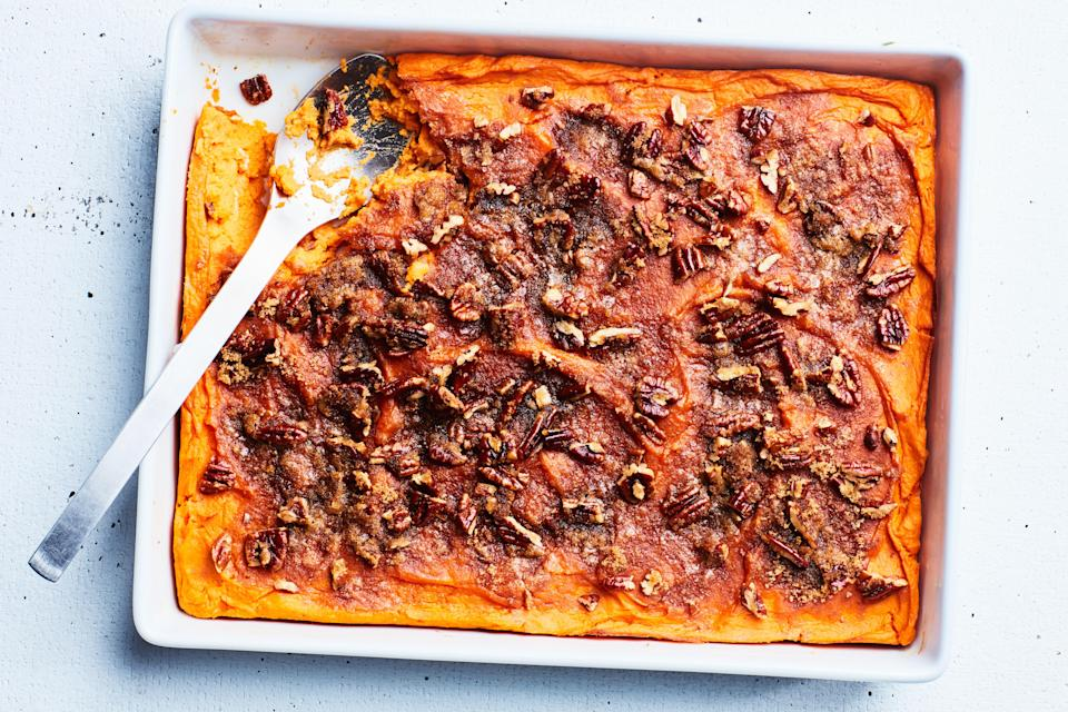 """This maple-sweetened casserole has a brown sugar and pecan topping that bakes into a crunchy candylike crust. It's a Thanksgiving day classic. <a href=""""https://www.epicurious.com/recipes/food/views/mashed-sweet-potatoes-with-brown-sugar-and-pecans-15683?mbid=synd_yahoo_rss"""" rel=""""nofollow noopener"""" target=""""_blank"""" data-ylk=""""slk:See recipe."""" class=""""link rapid-noclick-resp"""">See recipe.</a>"""