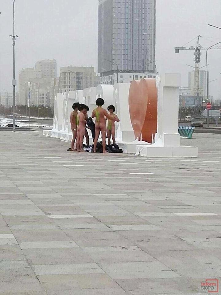 """In this image made available by informburo.kz, on Wednesday Nov. 15, 2017 shows a group of Czech tourists dressed in swimsuits made famous by TV and film character Borat in Atana, Friday Nov. 10, 2017. The group of six Czech tourists who visited Kazakhstan dressed up in the skimpy swimsuits have reportedly been detained by authorities in the central Asian country's capital Astana. Sporting lime green """"mankinis"""" and black wigs, the men had hoped to take a picture in front of the """"I Love Astana"""" sign. But local police detained them on Friday and fined them 22,500 tenge ($68) each, according to the Kazakh news website informburo.kz. (informburo.kz, via AP)"""