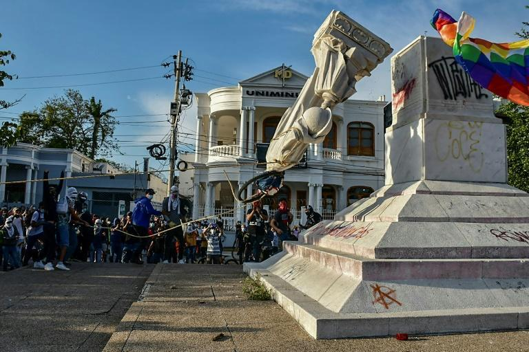 Demonstrators toppled a statue of the country's namesake, Christopher Columbus, in Barranquilla in the north