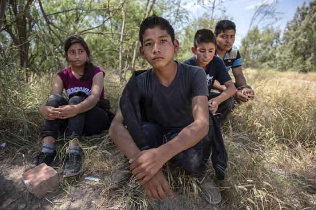 A group of unaccompanied minors shortly after being detained by Border Patrol south of McAllen, Texas. (Photo: Sergio Flores for Yahoo News)