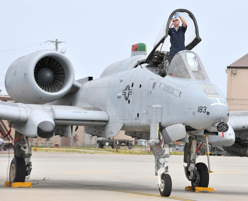 A US Air Force airman cleans the canopy of an A-10 Thunderbolt aircraft in Osan, South Korea on April 14, 2009