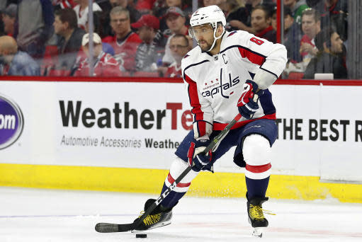 FILE - In this April 18, 2019, file photo, Washington Capitals' Alex Ovechkin (8) works the puck against the Carolina Hurricanes during the first period of Game 4 of an NHL hockey first-round playoff series, in Raleigh, N.C. Ovechkin doesnt think hes any lighter going into his 14th NHL training camp. The same 260, he said. That might be a slight exaggeration for a player listed at 235 pounds, though the Capitals captain worked to be leaner and quicker. (AP Photo/Karl B DeBlaker, File)