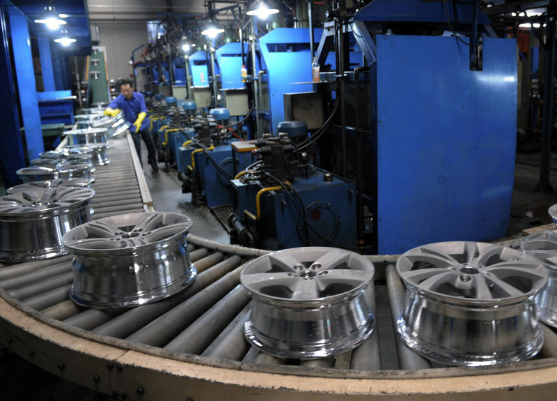 A worker labors at a factory making automobile wheels in Shaoxing city in east China's Zhejiang province on Monday April, 15, 2013. China's economic growth slowed unexpectedly in the first three months of the year, fueling concern about the strength of its shaky recovery. (AP Photo) CHINA OUT