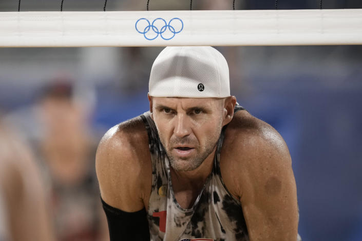 Jacob Gibb, of the United States, waits for play during a men's beach volleyball match against Italy at the 2020 Summer Olympics, Sunday, July 25, 2021, in Tokyo, Japan. (AP Photo/Felipe Dana)