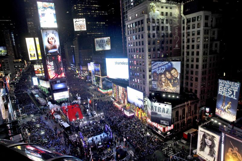"""FILE - In this Dec. 31, 2011 file photo, the crowd packs New York's Times Square during the New Year's Eve celebration as seen from the Marriott Marquis hotel. It's no small task making sure the annual celebration remains safe, but the New York City police use an array of security measures for the event that turns the """"Crossroads of the World"""" into a massive street party in the heart of Manhattan. (AP Photo/Mary Altaffer, File)"""