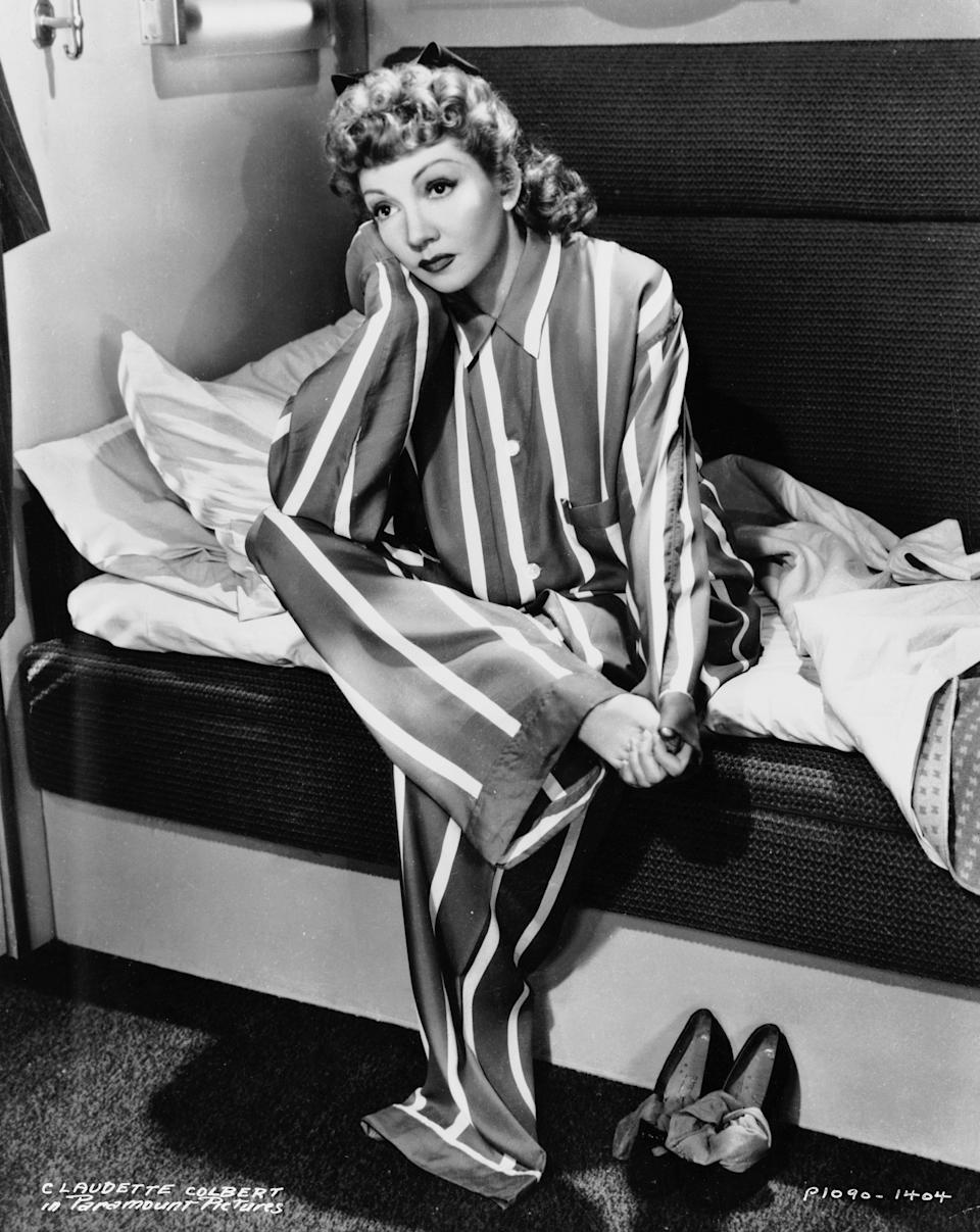 """Colbert wears a striped pajama set in """"The Palm Beach Story,"""" 1942."""