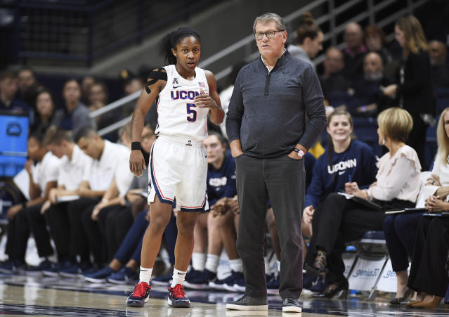 Connecticut head coach Geno Auriemma, right, talks with Connecticut's Crystal Dangerfield (5) during the first half of an NCAA college exhibition basketball game against Jefferson, Sunday, Nov. 3, 2019, in Storrs, Conn. (AP Photo/Jessica Hill)