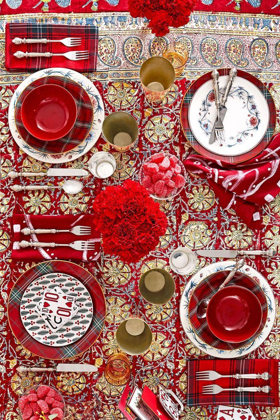 <p>Styled by Sara Rodrigues and Robert Rufino for House Beautiful, this festive Christmas brunch table is easier to create than it looks. Pair grocery-store carnations with tartan patterns, cinnamon candy, classic holiday motifs, and a pattern-packed tablecloth.</p>