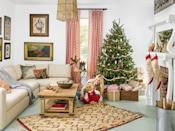 """<p>Vintage Christmas decorations scored from antiques malls add rustic charm to a living room grounded in neutrals.</p><p><strong><a class=""""link rapid-noclick-resp"""" href=""""https://www.amazon.com/Kurt-Adler-Cream-Stockings-Assorted/dp/B003WNCNDO?tag=syn-yahoo-20&ascsubtag=%5Bartid%7C10050.g.1247%5Bsrc%7Cyahoo-us"""" rel=""""nofollow noopener"""" target=""""_blank"""" data-ylk=""""slk:SHOP STOCKINGS"""">SHOP STOCKINGS</a></strong></p>"""