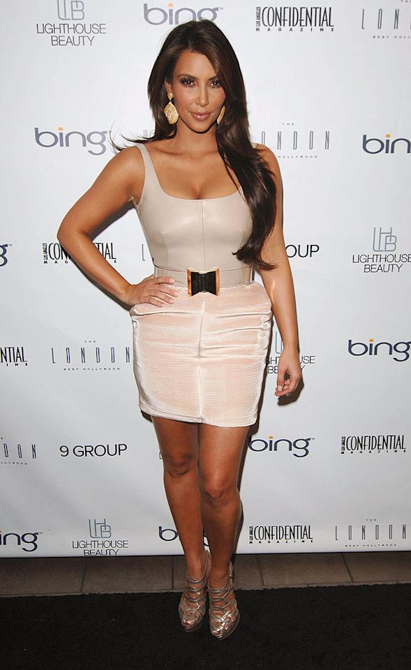 """Kim Kardashian -- who wowed the crowd in Marchesa at last weekend's Emmy Awards -- donned a Hannah Marshall corduroy mini skirt and luxurious leather top to <i>Los Angeles Confidential's</i> Fall Fashion Issue Party at The London Hotel in West Hollywood, California. A clear Gianfranco Ferre belt, Loren baubles, and Louboutin heels completed her look. Craig Barritt/<a href=""""http://www.wireimage.com"""" target=""""new"""">WireImage.com</a> - August 25, 2010"""