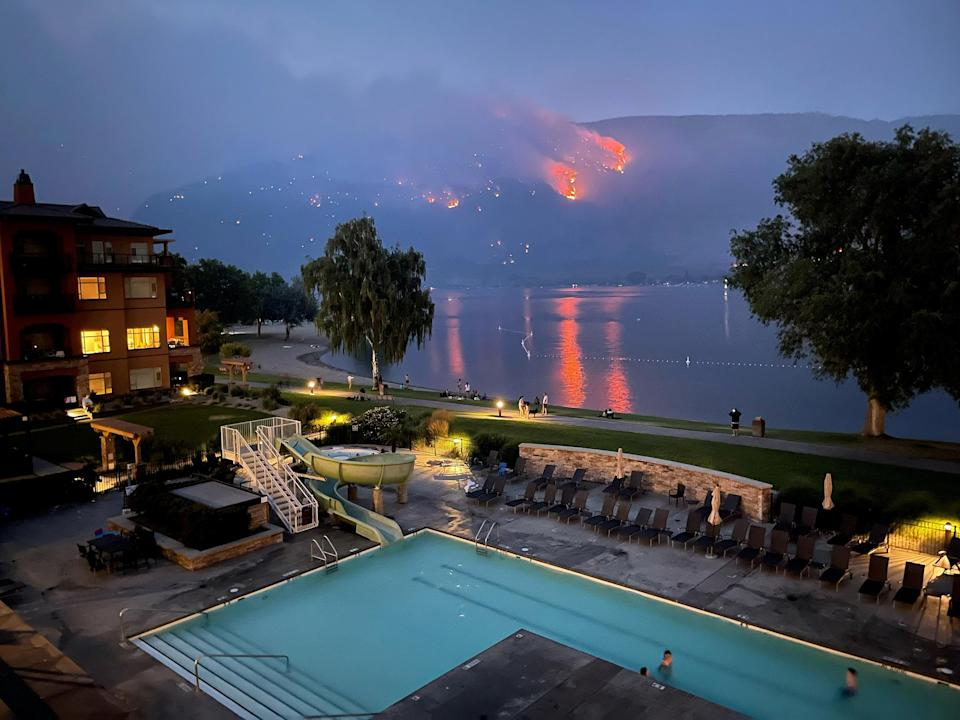 """View of a beach resort as a wildfire burns on a hillside in Osoyoos, British Columbia, Canada, on July 20.<span class=""""copyright"""">Sara Mahony—Reuters</span>"""