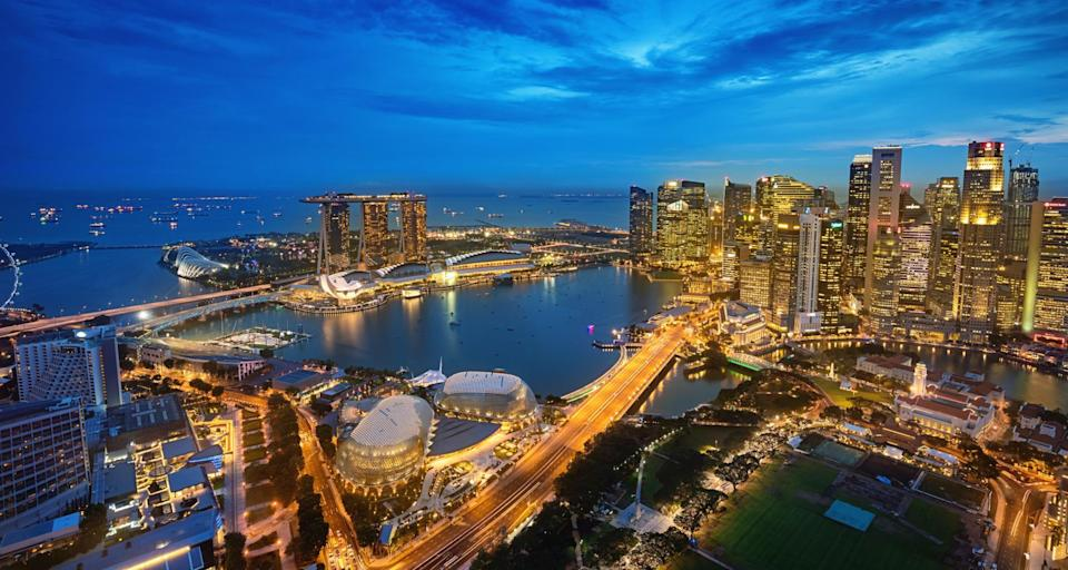 Aerial view over downtown singapore at Dusk towards the modern Business District Skyscrapers over The Singapore City Hall, the National Gallery of Singapore, Padang Singapore and the Singapore Cricket Club, Marina Bay and Marina Bay Sands Hotel in the background. Singapore City, Downtown - Marina Bay District, Asia. XXXL Photo, made with Sony A7RII.